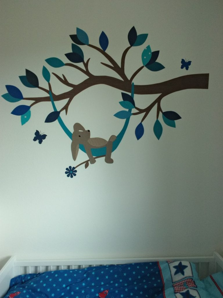 Haas in hangmat muurdecoratie babykamer behang